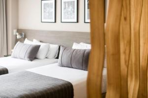 Cama ou camas em um quarto em CasaSur Bellini Hotel