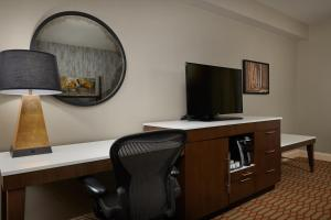 A television and/or entertainment center at Virginia Crossings Hotel, Tapestry Collection by Hilton