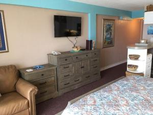 A television and/or entertainment center at Daytona Beach Hawaiian Inn