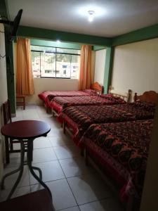 Cama o camas de una habitación en Artesonraju Hostel Huaraz