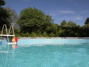 The swimming pool at or near Spacious Holiday Home with Private Pool in Auriac France