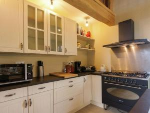 A kitchen or kitchenette at Spacious Holiday Home with Private Pool in Auriac France