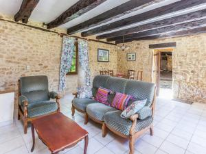 A seating area at Quaint Holiday Home in Sainte-Foy-de-Belves with Swimming Pool