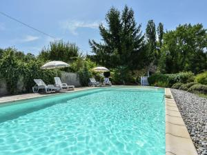 The swimming pool at or near Traditional Holiday Home In Loubejac with Swimming Pool