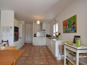 A kitchen or kitchenette at Comfortable Villa with private pool in Vidauban