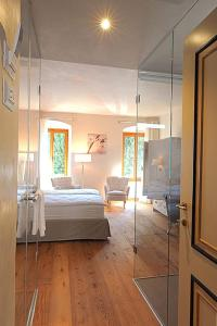 A bed or beds in a room at Casa L'Andrunèl