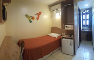 Cama ou camas em um quarto em Vitória Praia Hotel