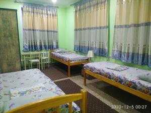 A bed or beds in a room at Hostel Bukhara Gold
