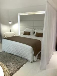 A bed or beds in a room at Hotel Rieger