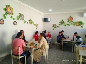 A restaurant or other place to eat at Hostel Bukhara Gold
