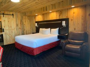 A bed or beds in a room at Americas Best Value Inn Wall
