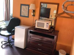 A television and/or entertainment center at Medical Inn Oklahoma City