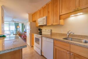 A kitchen or kitchenette at Napili Sunset Beach Front Resort