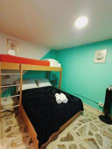 A bunk bed or bunk beds in a room at La Playa Hostel & Rooftop