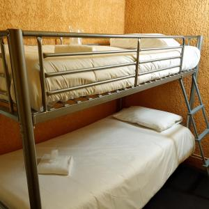 A bunk bed or bunk beds in a room at Libre Hôtel