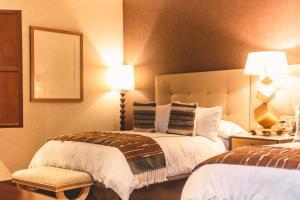 Cama o camas de una habitación en Tres Raíces