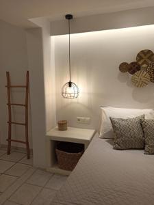 Ein Bett oder Betten in einem Zimmer der Unterkunft Sea View Apartments & Studios