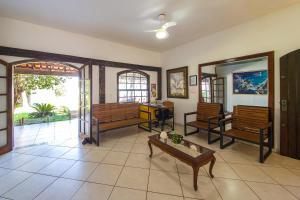 A seating area at Búzios Samba Hostel