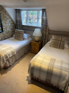 A bed or beds in a room at The George at Nunney
