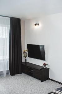 Televizors / izklaižu centrs naktsmītnē Z - apartment