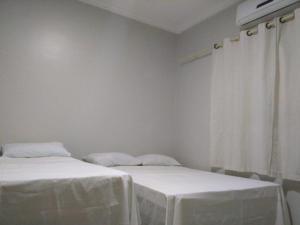 Cama o camas de una habitación en Pousada Aliança