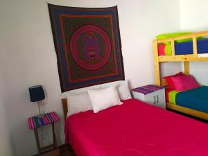 A bed or beds in a room at Dragonfly Hostels Miraflores