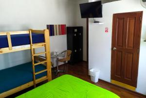 A bunk bed or bunk beds in a room at Dragonfly Hostels Miraflores
