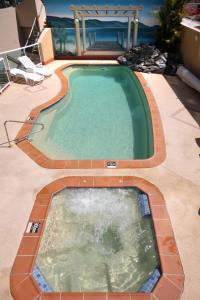 The swimming pool at or near Sails Apartments