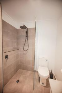 A bathroom at Bayview no 1 - Next to the Beach!
