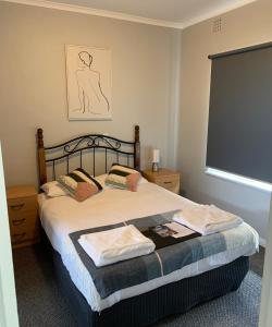 A bed or beds in a room at Hello Adelaide Motel and Apartments