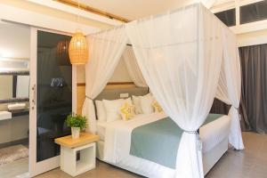 A bed or beds in a room at The Forty Eight Resort Candidasa