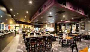 A restaurant or other place to eat at Nightcap at Skyways Hotel