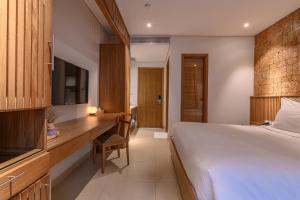 Cama ou camas em um quarto em Minh House
