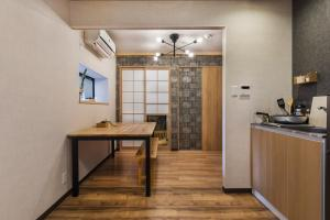 A kitchen or kitchenette at Hanamizuki NAMBA MINAMI