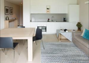A kitchen or kitchenette at Filario Hotel & Residences