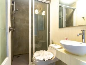 A bathroom at Montree Phuket Hotel