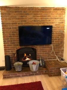 A television and/or entertainment center at Latchingdon cottage