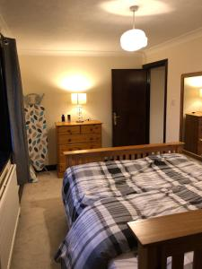A bed or beds in a room at Latchingdon cottage