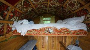A bed or beds in a room at Islay Westcote Glamping