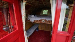 A bunk bed or bunk beds in a room at Islay Westcote Glamping