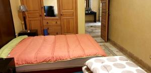 A bed or beds in a room at Apartment with 2 bedrooms in Marrakesh with shared pool and enclosed garden