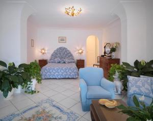 Ein Sitzbereich in der Unterkunft Hotel Villa Brunella