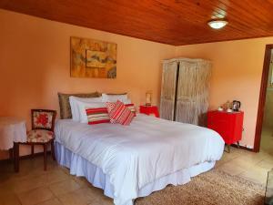 Cama ou camas em um quarto em Chalés Valle Florido