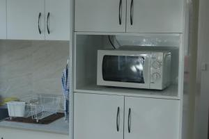 A television and/or entertainment center at FIJI HOME Apartment Hotel