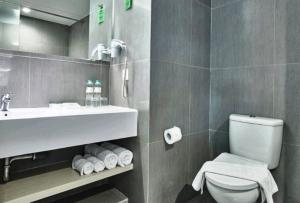 A bathroom at Zuri Express Lippo Cikarang