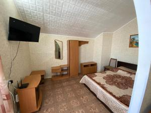A bed or beds in a room at Guest House 33 Shaga