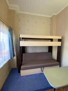 A bunk bed or bunk beds in a room at Guest House 33 Shaga
