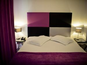 A bed or beds in a room at Apartment Adonis La Baule-1