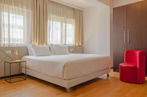 A bed or beds in a room at NH Collection Roma Giustiniano