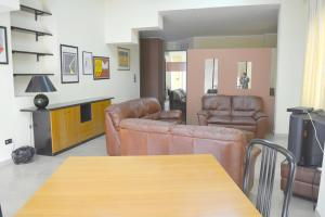 A seating area at Apartment with 2 bedrooms in Reggio Calabria 100 m from the beach